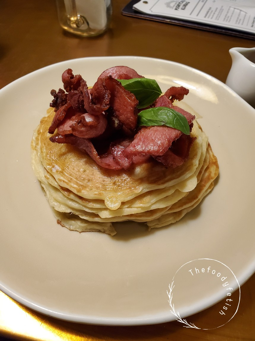 American pancake with bacon and maple syrup